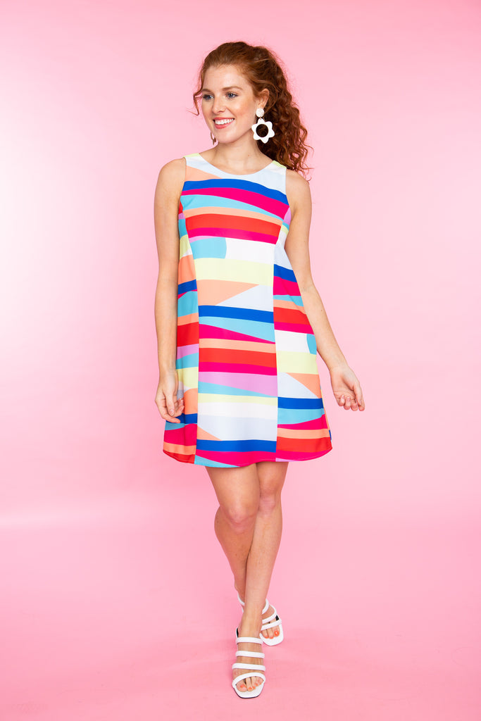 woman wearing short rainbow stripe sleeveless dress
