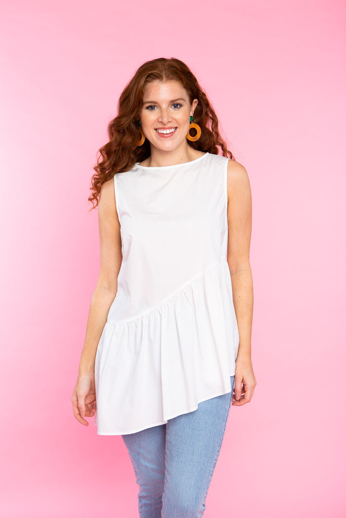 woman wearing cotton white tank top with hi low hem and large buttons up the back