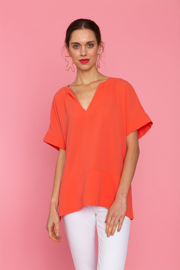 Woman in bright short sleeve v-neck tunic