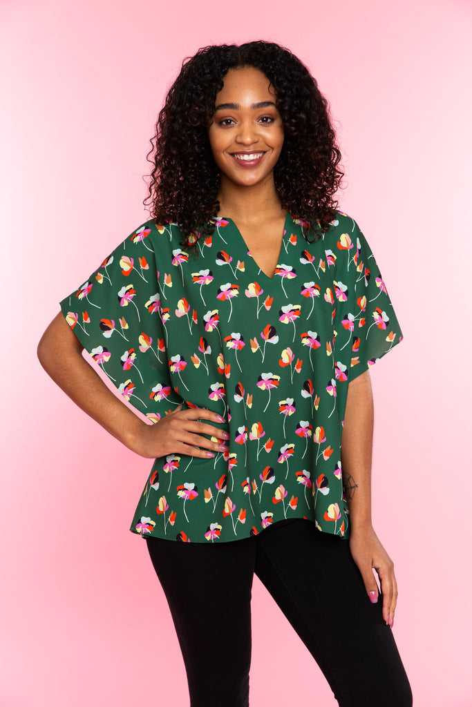 Woman in green floral v-neck tunic