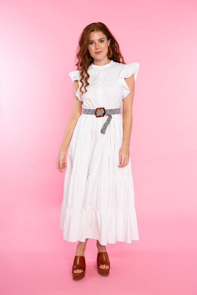 woman wearing white cottom maxi dress with ruffle sleeve and belt