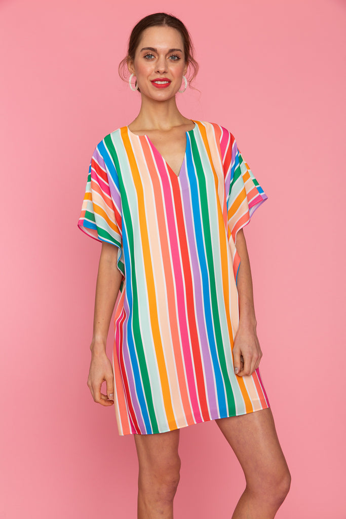 Woman in v neck bright striped caftan tunic dress