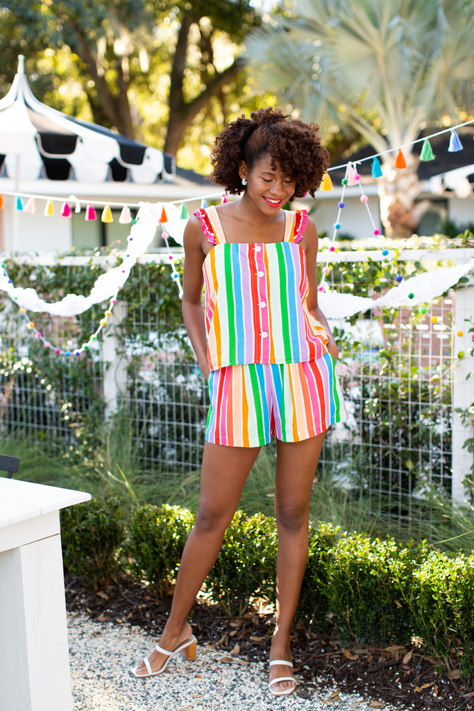 Black woman in stripe tank with buttons and matching stripe shorts