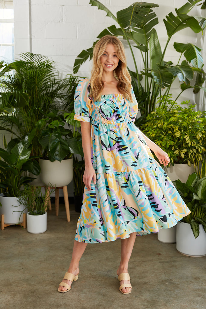 Bright tropical printed midi dress with smocked bodice and puff sleeve
