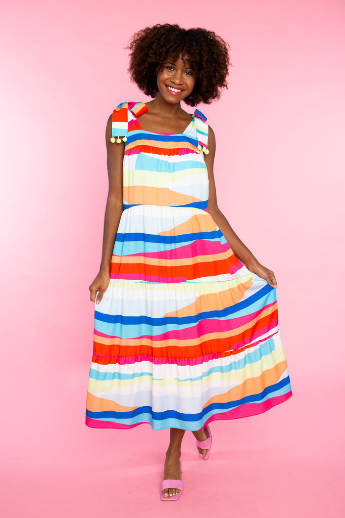 Black woman wearing colorful printed maxi dress