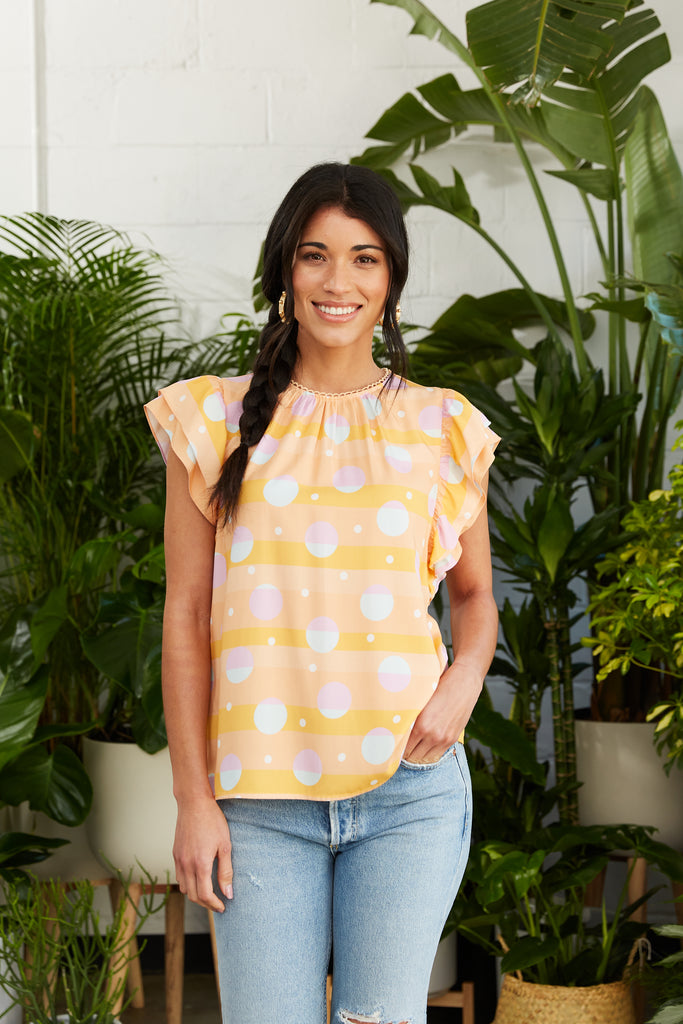 Orange printed top with double flutter sleeves