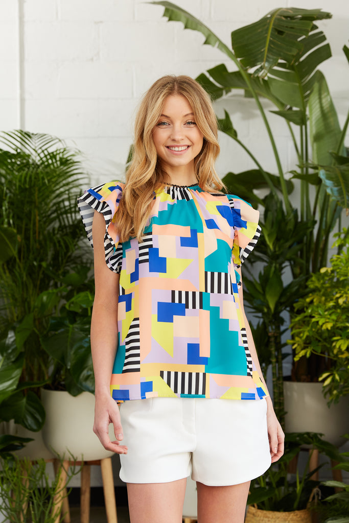 Bold geometric printed top with double flutter sleeves