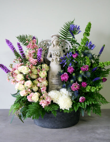 Fresh Floral Arrangement with Angel Statue
