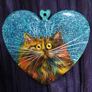 Rainbow tortie on blue sparkle - ornament