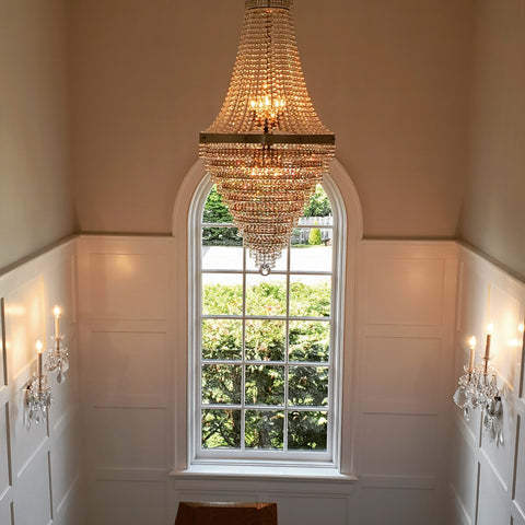 "24"" tiered chandelier trimmed in Swarovski"