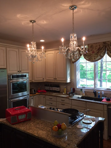 Using crystal chandeliers to make your kitchen glorious kings with a lack of crystal strandsfestoons and bobeches that lift straight off the candle this chandelier can be cleaned in an hour aloadofball Images