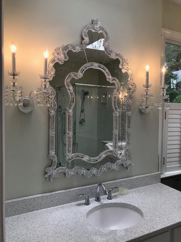 crystal sconces in a bathroom