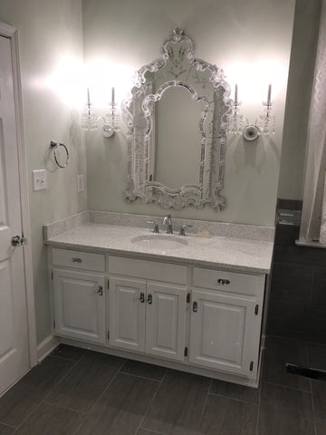 crystal sconces over a vanity