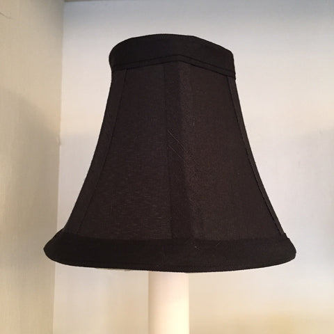 Black, clip-on chandelier shade.