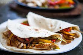CHICKEN FAJITAS WITH FRESH CORN, PICO DI GALLO, CARAMELIZED PEPPERS AND ONIONS, RICE