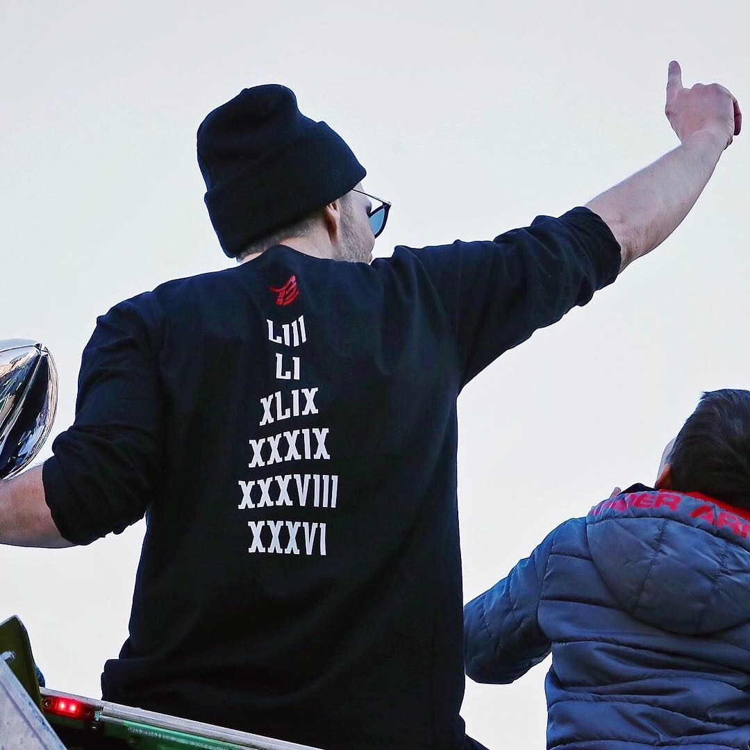 image of the back of the long-sleeve shirt, from Tom in the super bowl victory parade