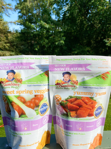 Sweetspring veggies and Yummy yams Bambino's baby food products outside in beautiful sunset