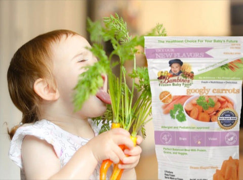 Cutie baby girl licking  loving Bambinos baby food organic googly carrots with olive oil