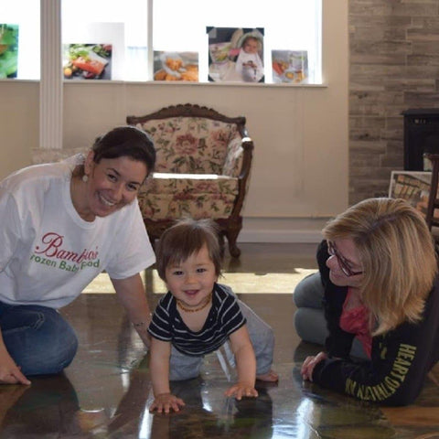 Zoi Maroudas Founder president plays on floor with grandma and cute baby
