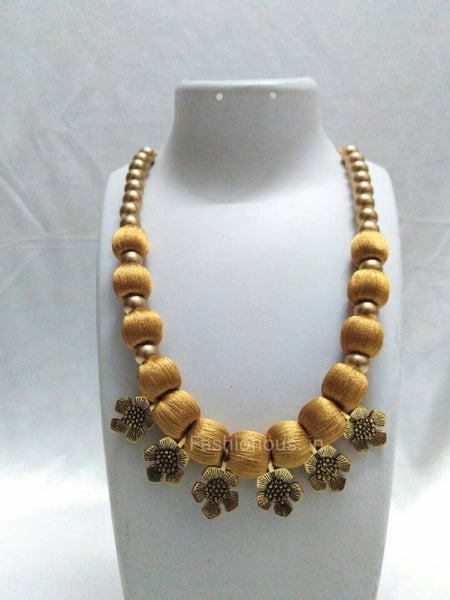 Gold colour flower charms necklace