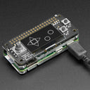 A product image of Adafruit 128x64 OLED Bonnet for Raspberry Pi