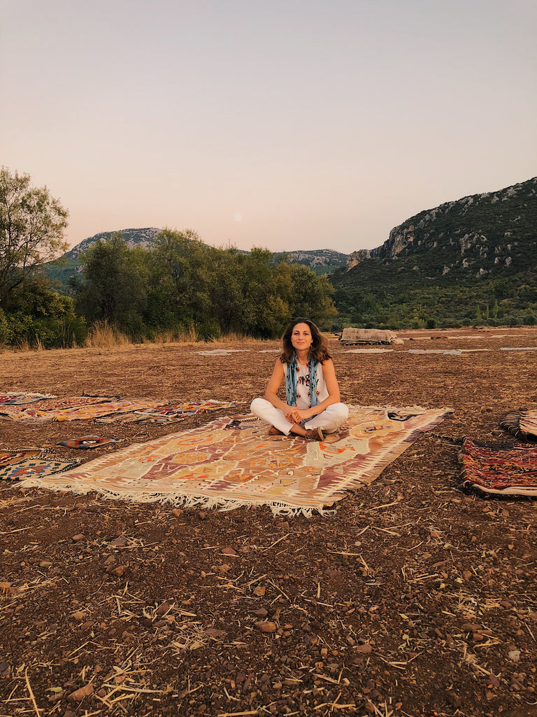 Beyza Nur from Wild Heart Free Soul on her flying kilim on the rug washers field in Antalya, Turkey