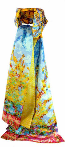 A stunning print featuring spring blossom in full bloom lined with a delicate lemon coloured chiffon print.  Our double sided cotton  scarves lined with chiffon, allow you to accessorise well into spring, wrapping up for cooler days, or adding a bright accent to an outfit. The exclusive one off print makes it a unique,  luxurious gift, or a special treat for yourself.