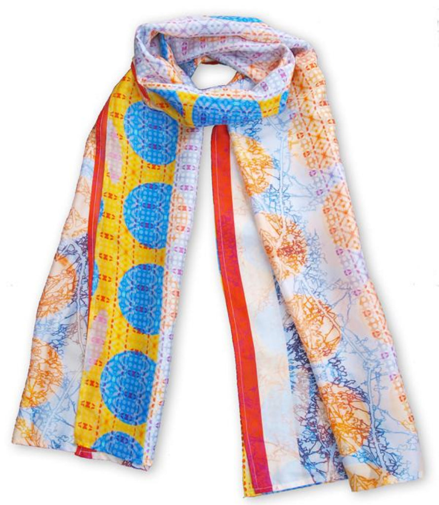 This scarf features geometric shapes and branch outlines. The print can look dramatically different depending on how you like to wear it.  Each print is a one off, which makes it a luxurious gift, or a special treat for yourself.  The scarves are designed to be worn as a statement piece with an   elegant outfit or tied snugly for a more casual look. Habotai silk   has a smooth texture, and is both light weight and warm