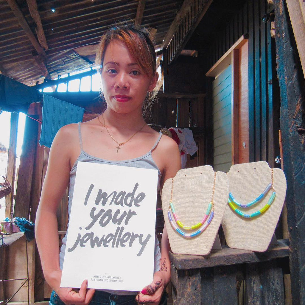 Jennifer, one of the artisans behind our Olivia & Diego jewellery, holds up a sign in support of Fashion Revolution Week