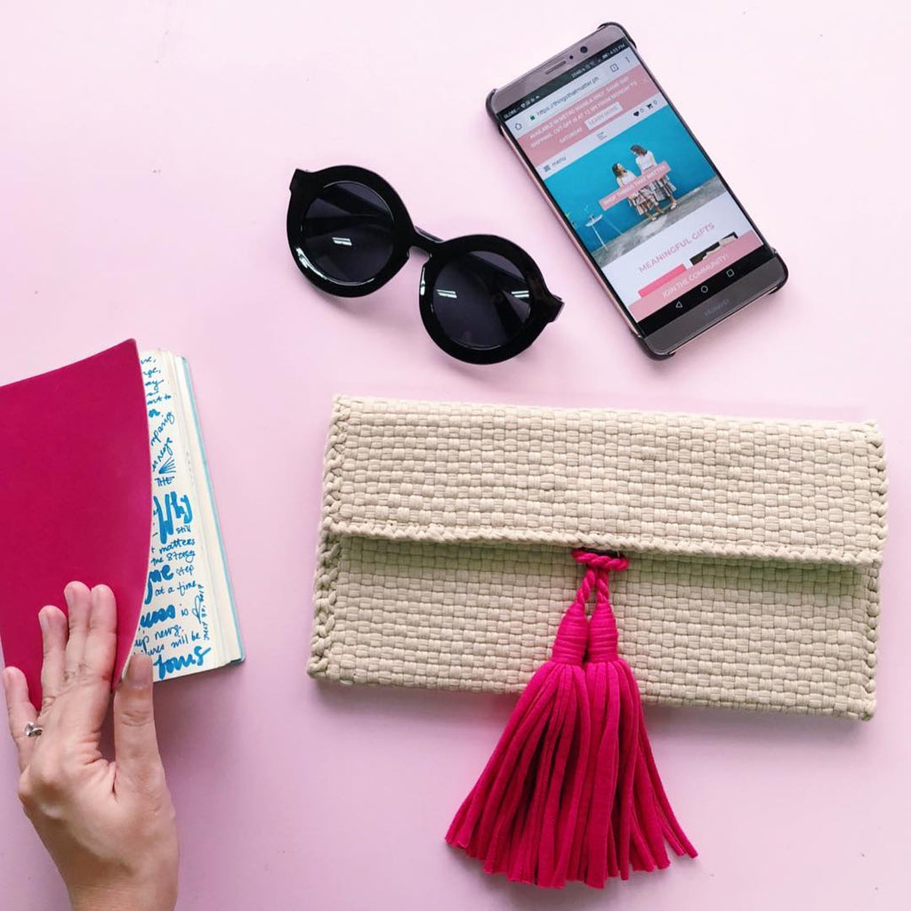 The Estelle Mini Clutch, handwoven from overstock, upcycled fabrics and indigenous materials.