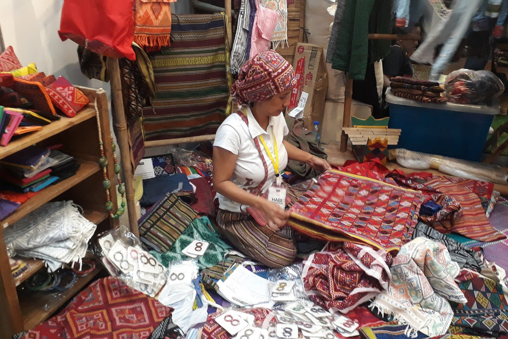 Yakan weaver Evelynda Otong from Basilan, Mindanao shows indigenous weaves and textiles at the 2019 Likhang Habi Market Fair in Manila, Philippines.
