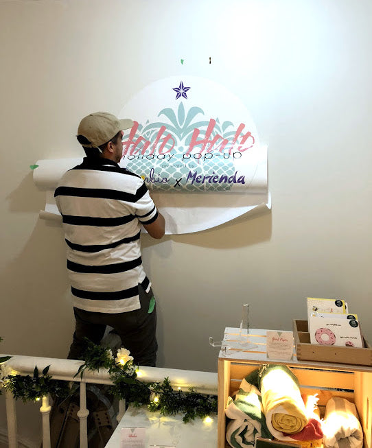 Installation of our sign - Halo Halo Holiday Pop-Up