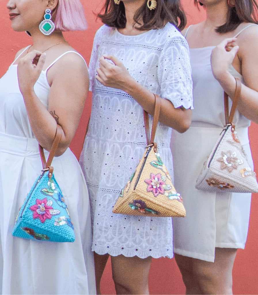 The Puso Hardin Clutch by Rags2Riches and sold on Cambio & Co. with hand-embroidered florals and crafted from upcycled fabrics by Filipino artisans in Manila, Philippines.