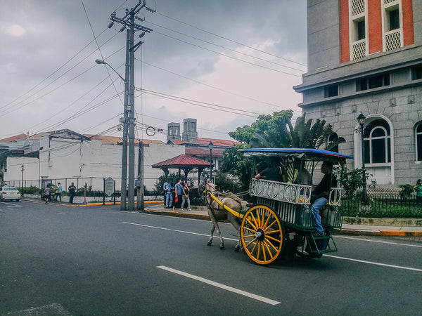 A kalesa tours people around the walled city of Intramuros in Manila