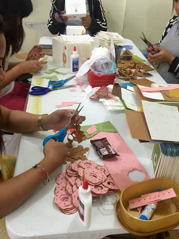 Women preparing the You Complete Me handcrafted card