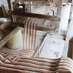 Naturally dyed abaca fibers being woven together in Bicol with Habin