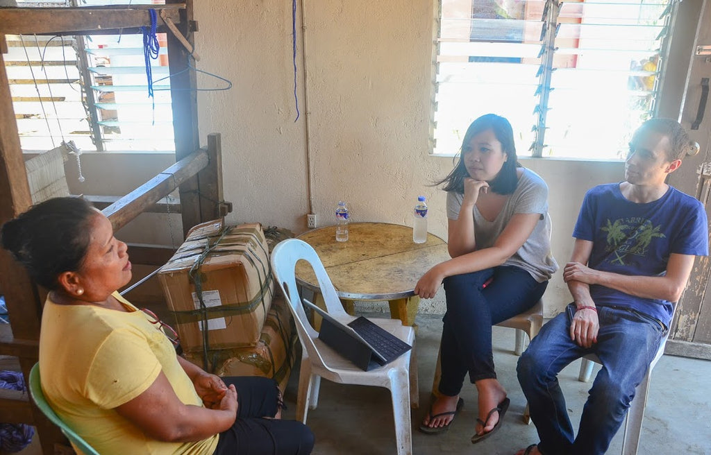 Us (Gelaine and Jérôme) speaking with Mary Jane, one of our AKABA weavers in Ilocos Norte