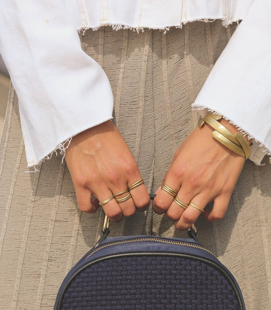 Better together, this brass bangle and woven backpack ensemble strike a perfect balance of traditional craftsmanship and contemporary style. All made by hand in the Philippines. (Find the Stacking Brass Rings & Thick Brass Bangles by Nawa and Cole Mini Backpack in Navy Blue by Rags2Riches right her on our online shop.)