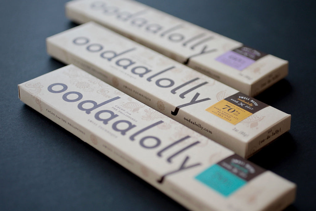The Oodaalolly Chocolate Bar Collection includes their three foundational bars: 70% Dark Chocolate with Almonds and Sea Salt, 60% Dark Milk Chocolate, and 70% Dark Chocolate