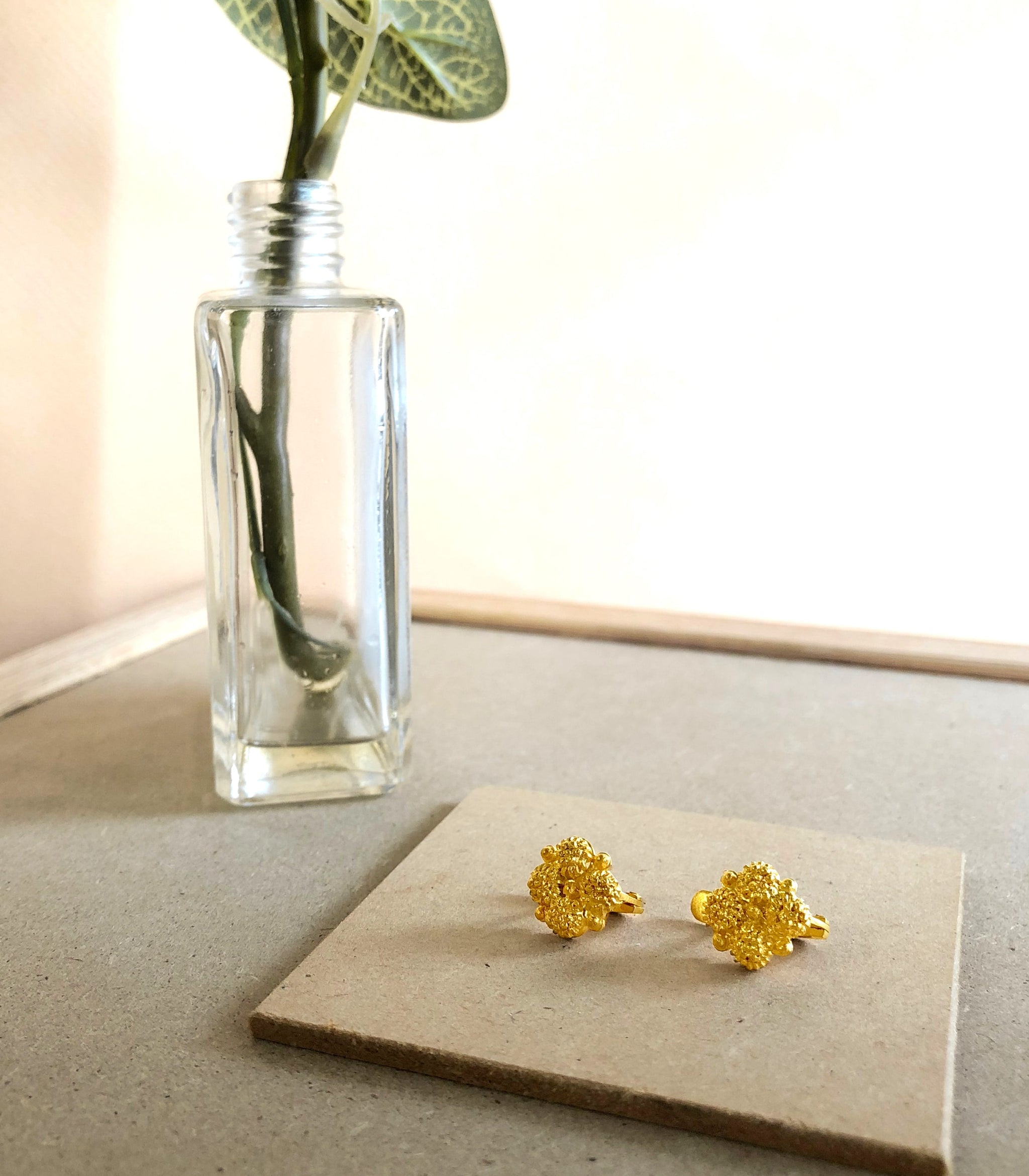 Estela Earrings on a table - AMAMI