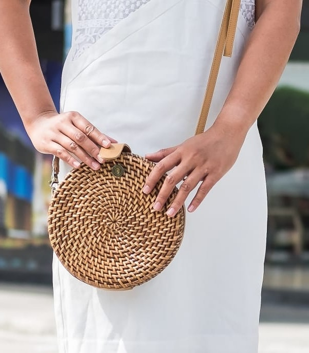 Alicia Rattan Crossbody in Brown with a model - Island Girl