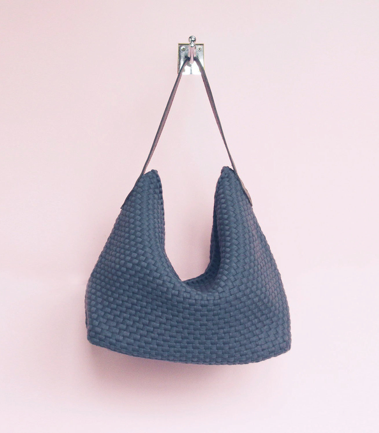 Buslo Hobo Bag in Charcoal Grey hanging on a wall - Rags2Riches