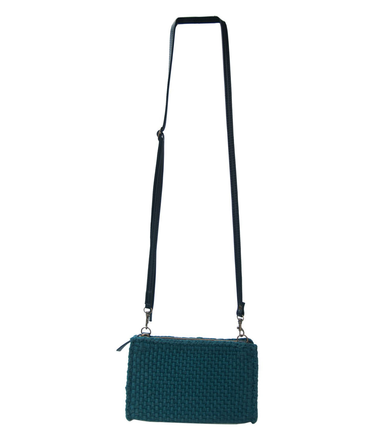 Clarence Travel Sling Bag in Emerald Green hanging on a wall with white background - Rags2Riches