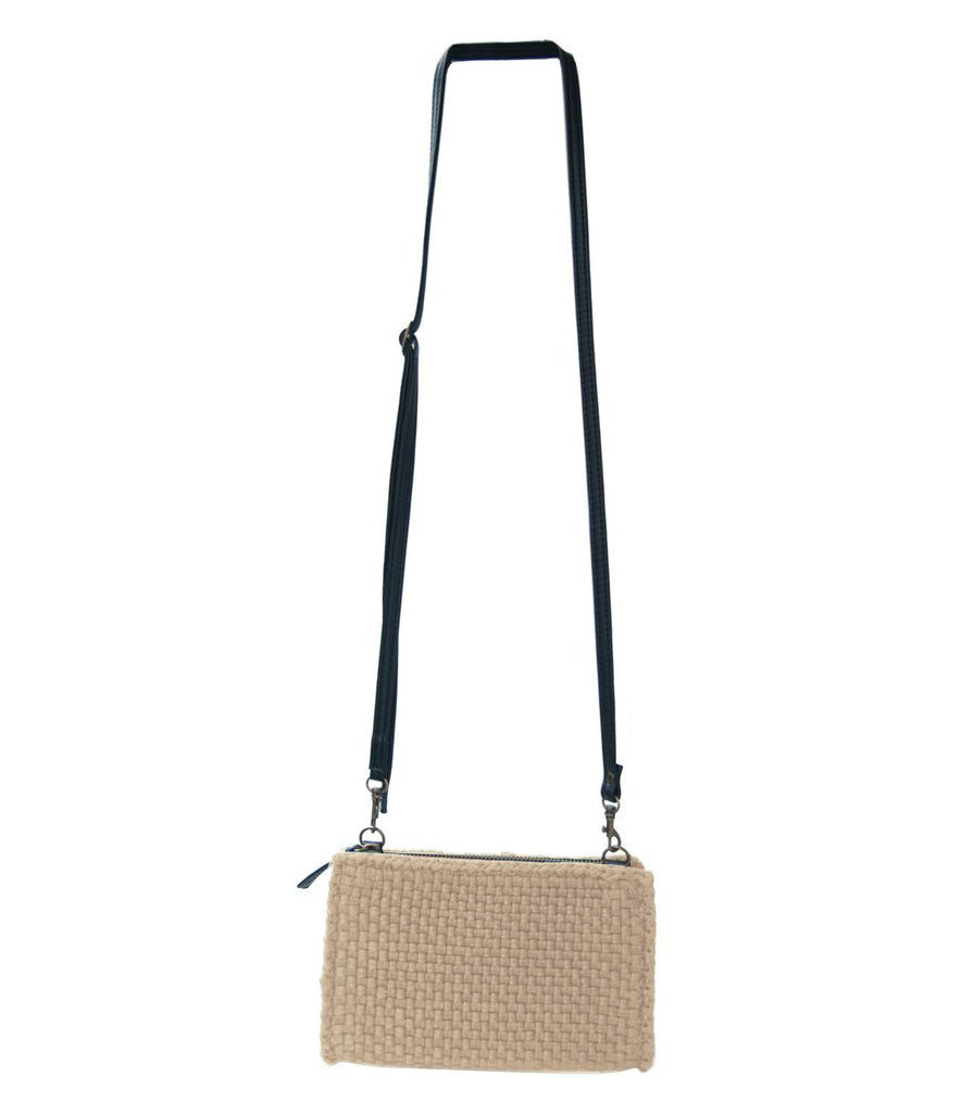 Clarence Travel Sling Bag in Mocha hanging on a wall with white background - Rags2Riches