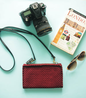 Clarence Travel Sling Bag model photo with camera sunglasses and a travel guide - Rags2Riches