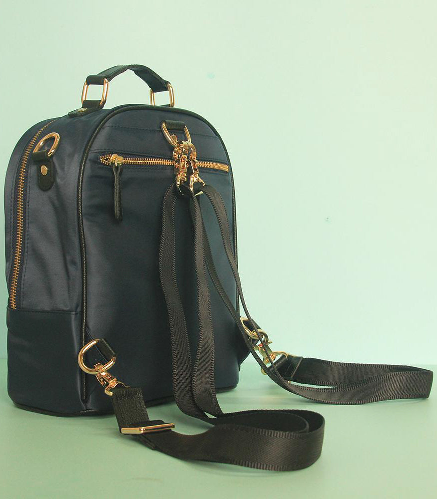 Cole Mini Backpack in Black showing the back view of the bag - Rags2Riches