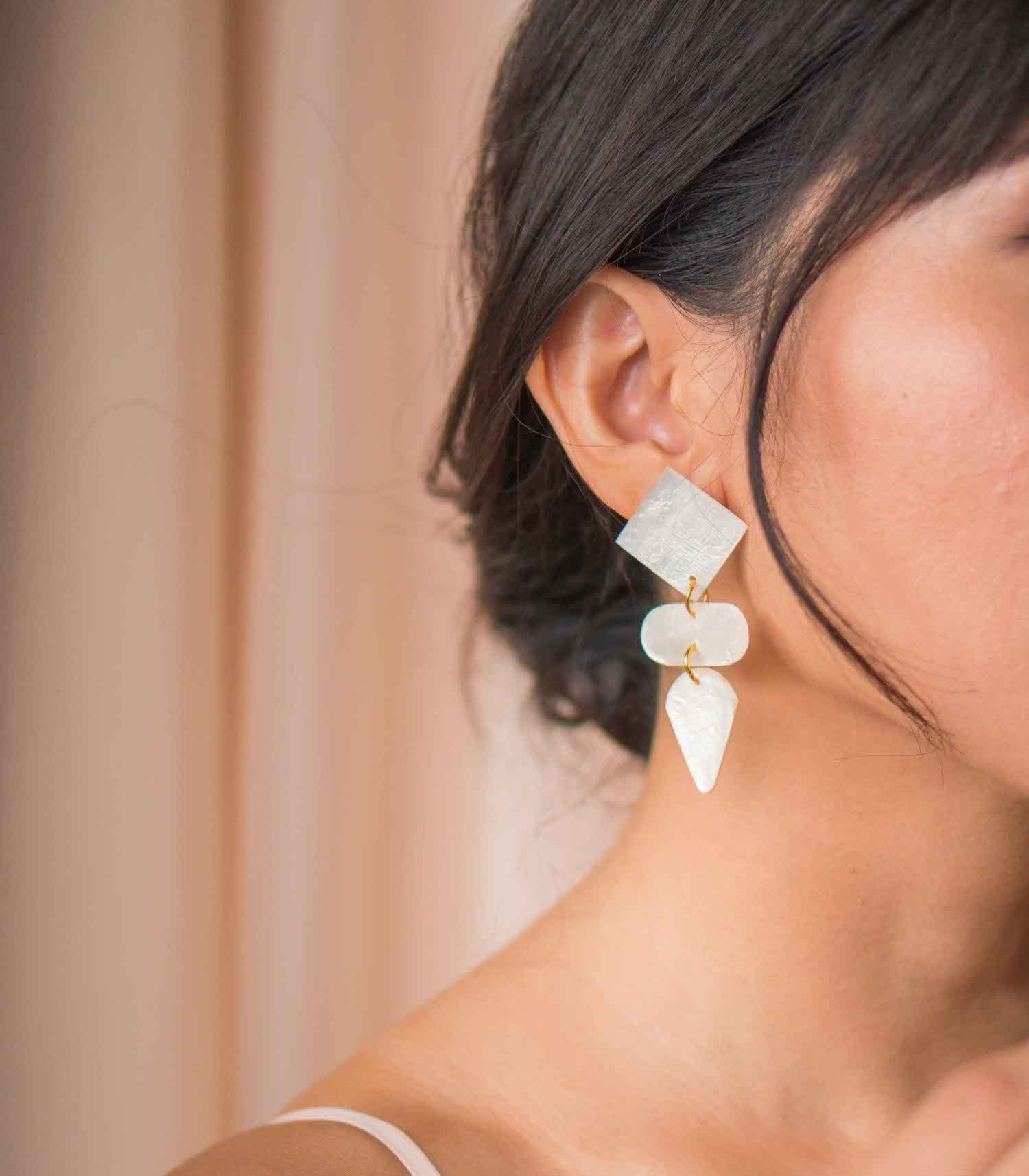 Renata Capiz Earrings on a model - Island Girl