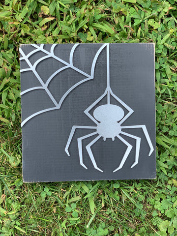 Spider in a web wooden sign