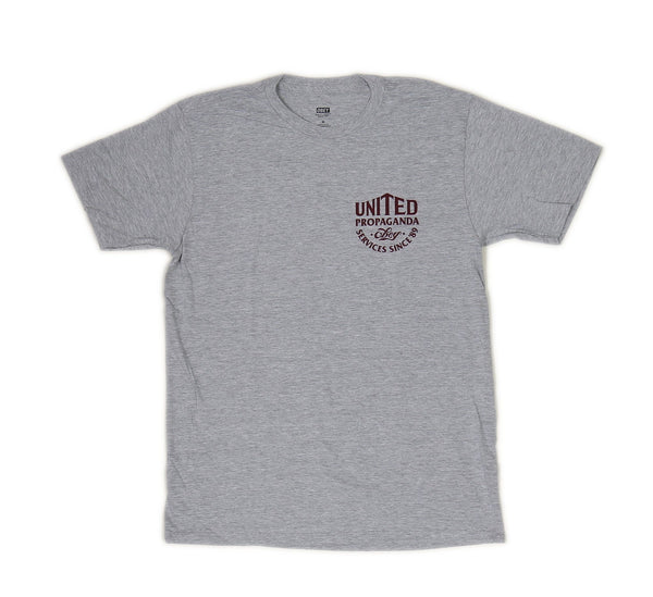 UNITED PROPAGANDA SERVICES TEE, HEATHER GREY