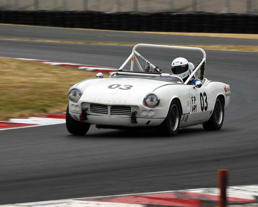 Patty Norlin with 1963 Triumph Spitfire in Group 1 - Small Bore Production Cars at the 2015 Portland Vintage Racing Festival at Portland International Raceway